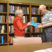 senior couple picking out a book