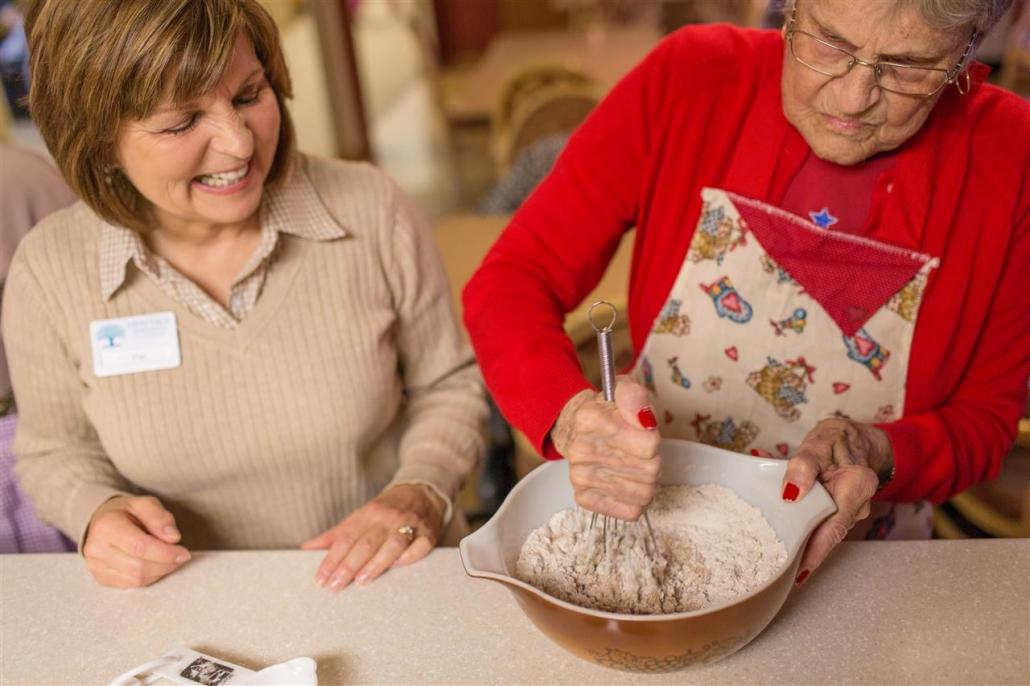 senior woman mixing flour