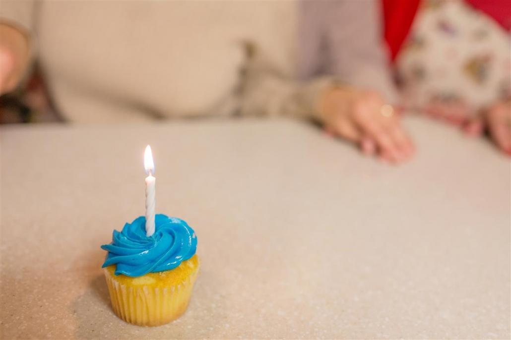 candlelit birthday cupcake