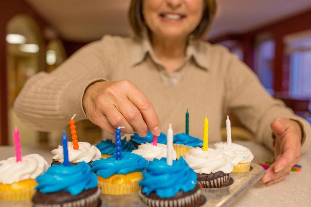 woman decorating cupcakes